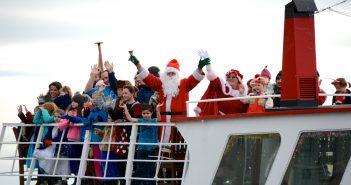 Santa arriving by boat