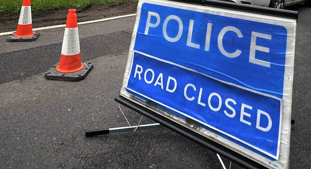 image of police road closed sign