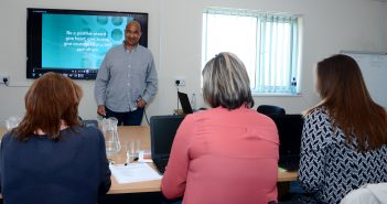 Adult learners receiving training