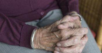 An elderly person's hands