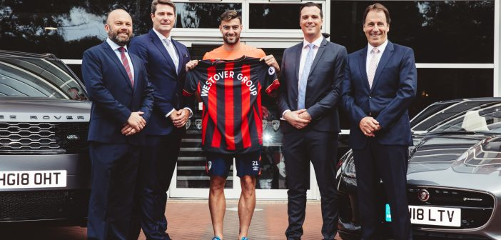 Westover Group and AFC Bournemouth holding team shirt