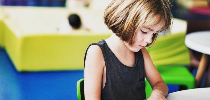 Child doing craft activity