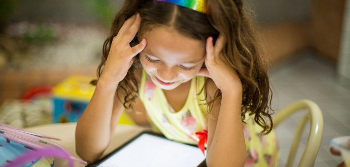Young girl using computer