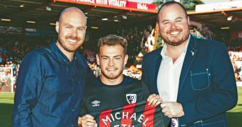 Bournemouth player presenting a shirt to the business