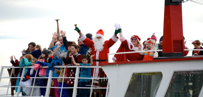 Santa arriving by boat