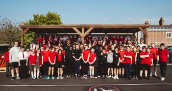Image of kids at Pokesdown Primary School with Nathan Ake and Jordon Ibe from AFC Bournemouth