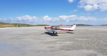 image of a private plane on a beach