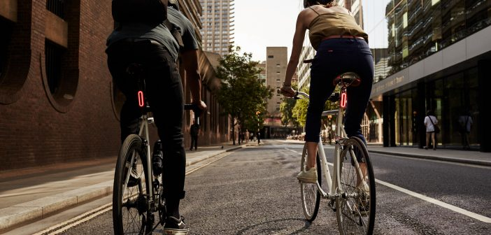 image of two people cycling
