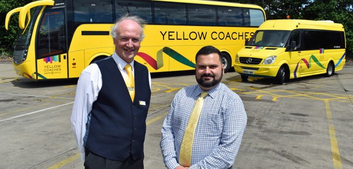Two men stood by a coach