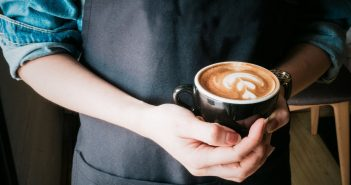 A person holding a coffee