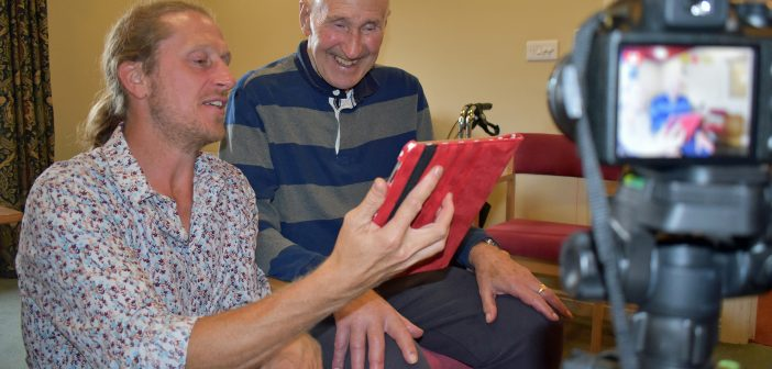 Malcolm Burgin from the Alive charity with resident Ken Cobb.