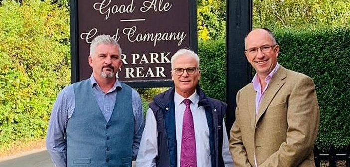 Phil Hoyle, landlord of the London Tavern, Sir Desmond Swayne MP and Rob Lowe, area manager for EI group.