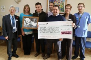 cheque for cancer charity