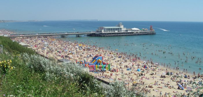 image of a packed bournemouth beach