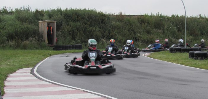 image of racers from South Coast Kart Club driving on the track
