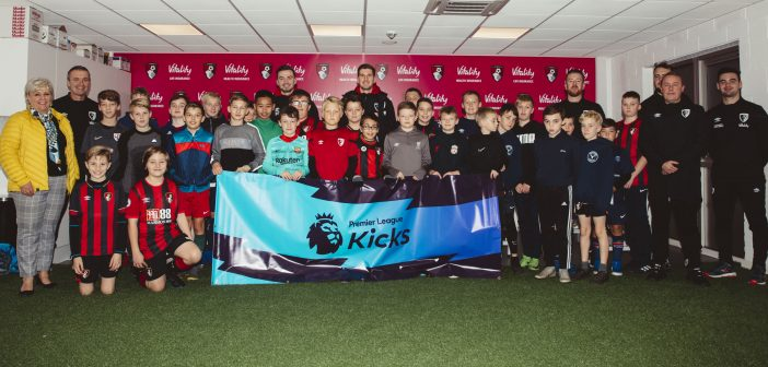 Image of AFC Bournemouth stars Matt Butcher and Chris Mepham with the youngsters at one of the Premier League Kicks sessions at Vitality Stadium