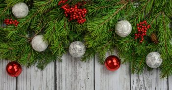 image of christmas decorations over a wooden fence