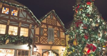 image of a traditional christmas village with a christmas tree and victorian style houses